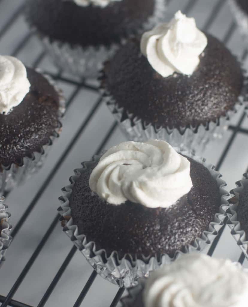 Marshmallow mocha cupcakes are filled with marshmallow creme and topped with mocha frosting. They're the perfect dessert for the coffee lover in your life.