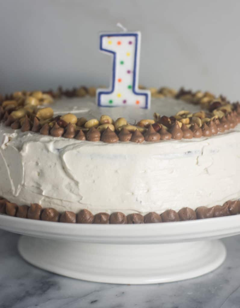 Dark Chocolate Cake with Vanilla Peanut Butter Frosting is the best way I know to celebrate my blog's birthday, or any other day for that matter.