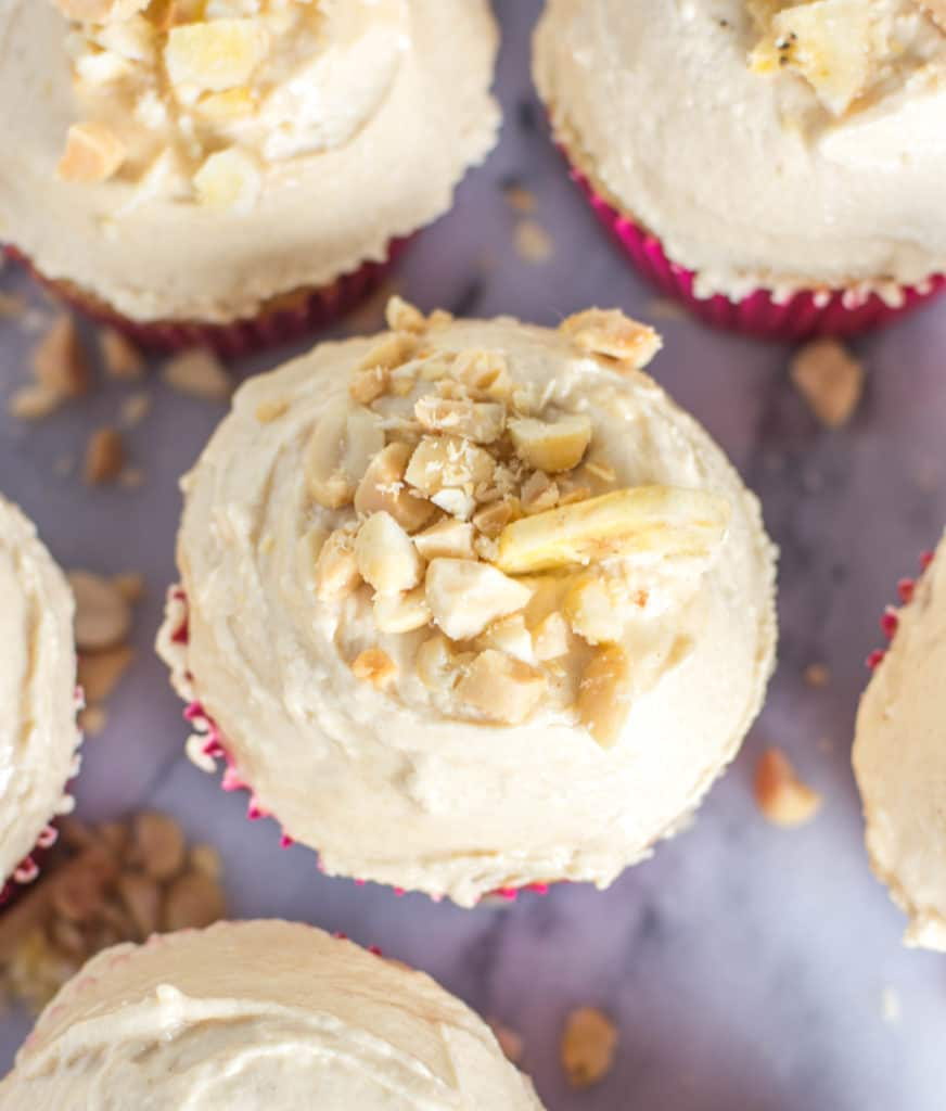 overhead shot of banana cupcakes with peanut butter frosting after they've been frosted and decorated