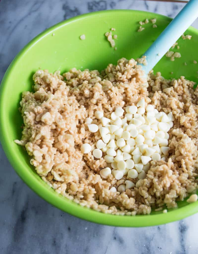 mixing bowl with ingredients for white chocolate Irish cream Rice Krispie treats