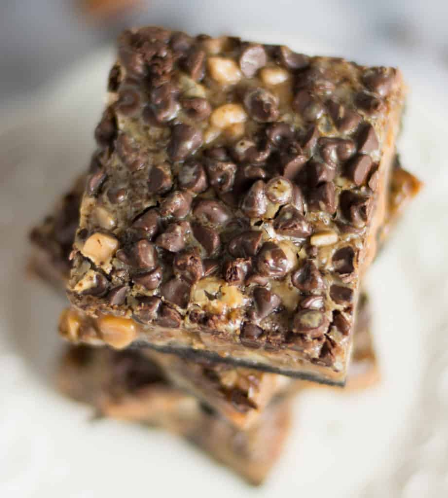 overhead shot of a stack of coffee-toffee caramel cookie bars on a plate