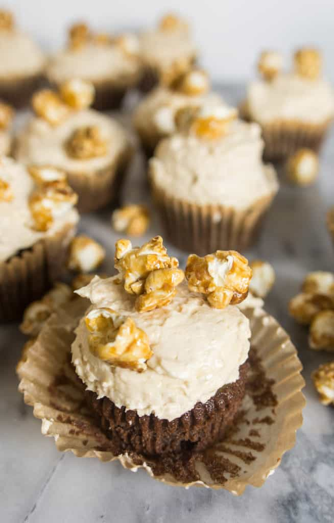 chocolate caramel corn cupcake with the cupcake liner peeling off