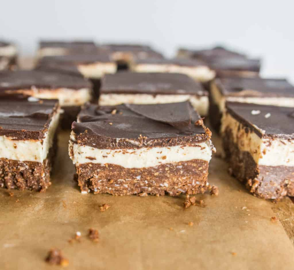 sliced Nanaimo bars on a piece of parchment paper