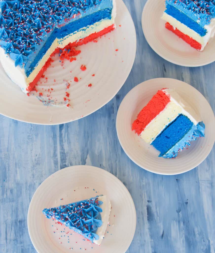overhead shot of slices of Fourth of July cheesecake cake on plates
