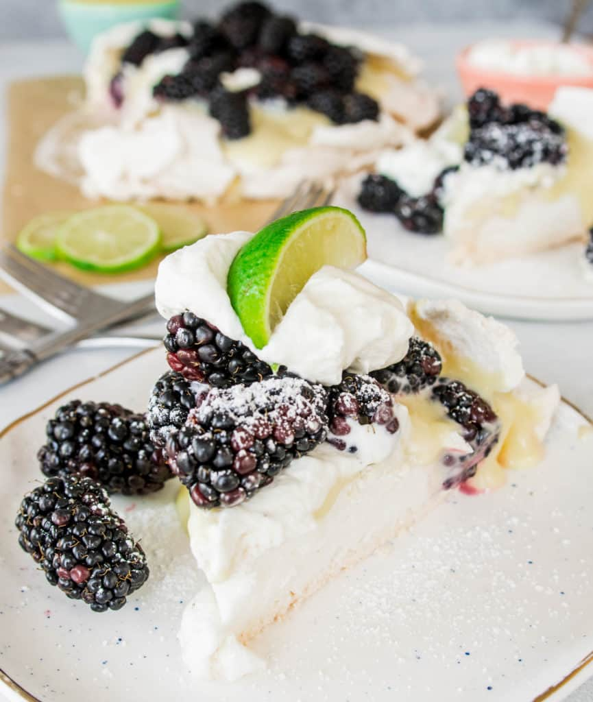 slice of blackberry, lime, and cardamom pavlova on a plate