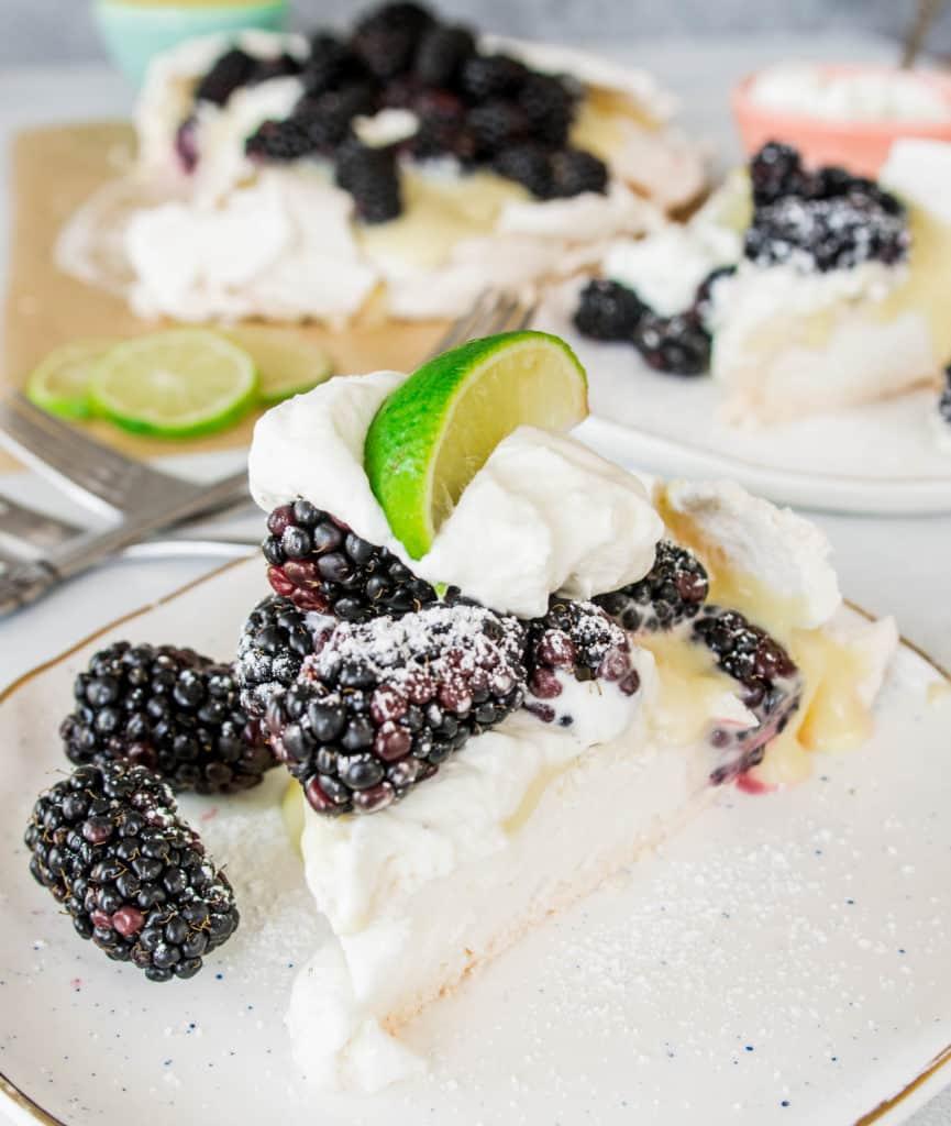 slice of blackberry, lime, and cardamom pavlova on a plate