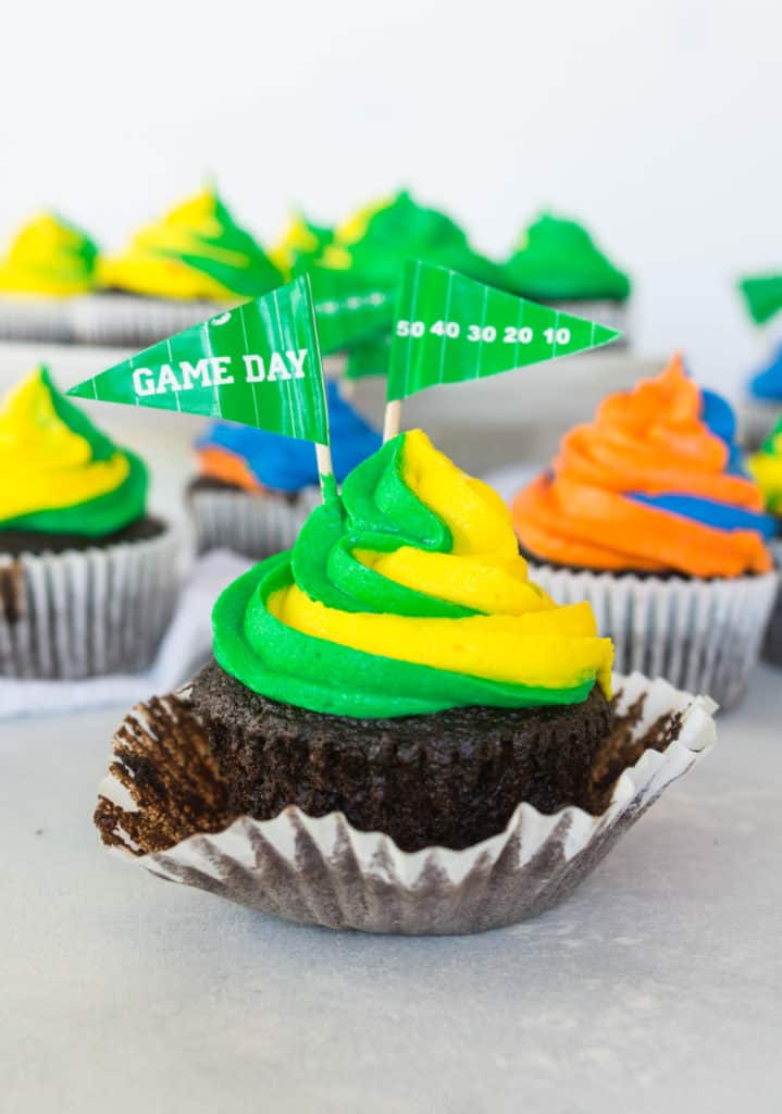 game day chocolate marshmallow cupcakes on a plate with the wrapper peeled down