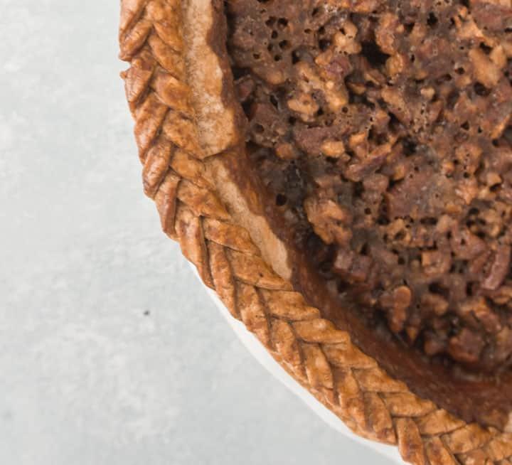 overhead photo of the sweet potato pecan pie with braided crust around the pie's edge