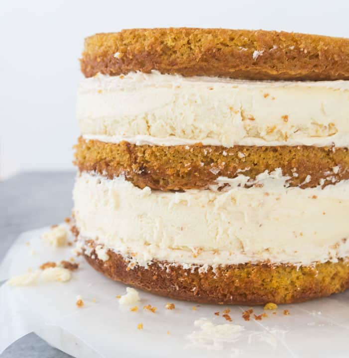unfrosted pumpkin cheesecake layer cake with all of the layers stacked