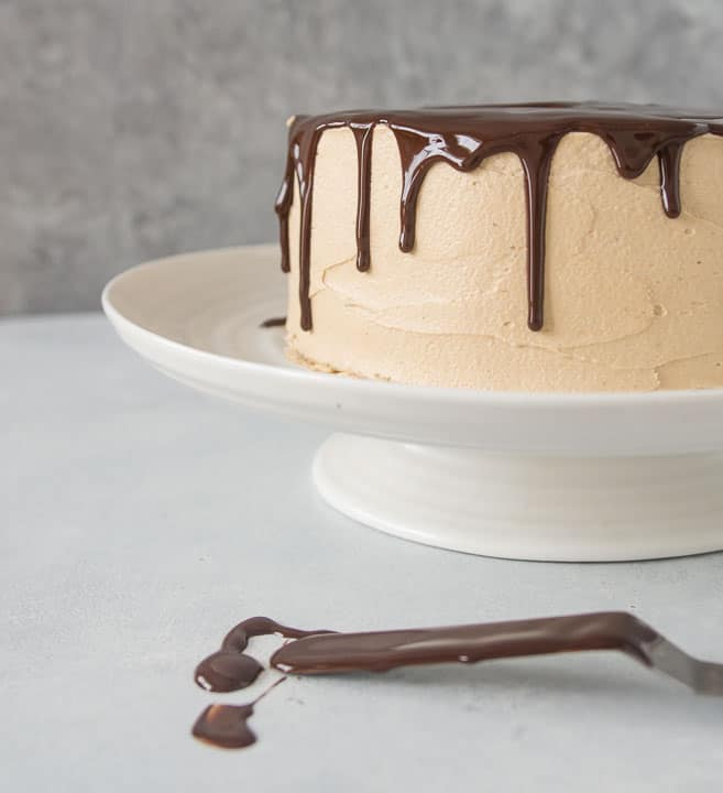 white chocolate layer cake with hazelnut espresso buttercream and chocolate ganache dripping down the sides