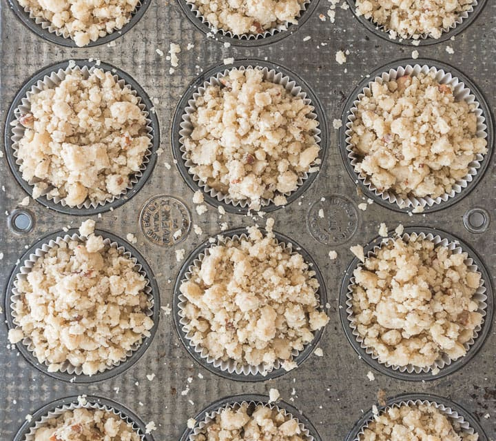 overhead shot of white chocolate cranberry crumb muffins in the muffin tin