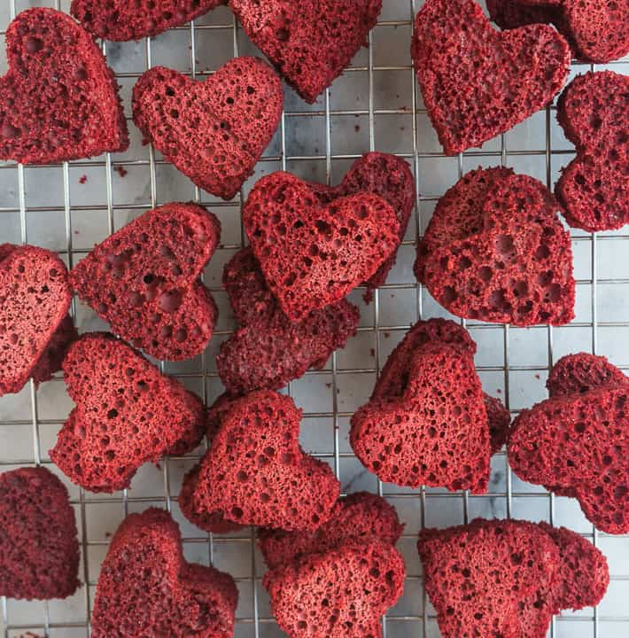 cutout hearts to go inside hidden heart bundt cake set on a wire rack