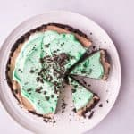 overhead shot of no-bake mint mocha cheesecake with two slices cut out