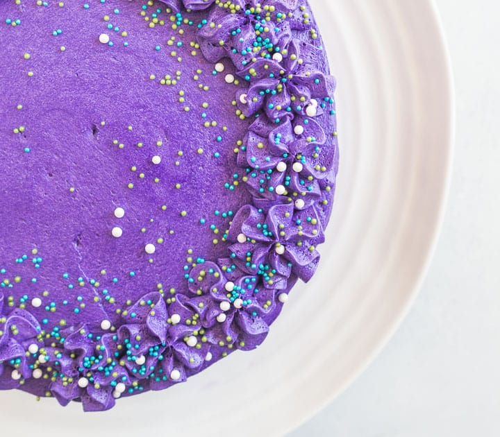 overhead shot of the mermaid cake with purple frosting and sprinkles