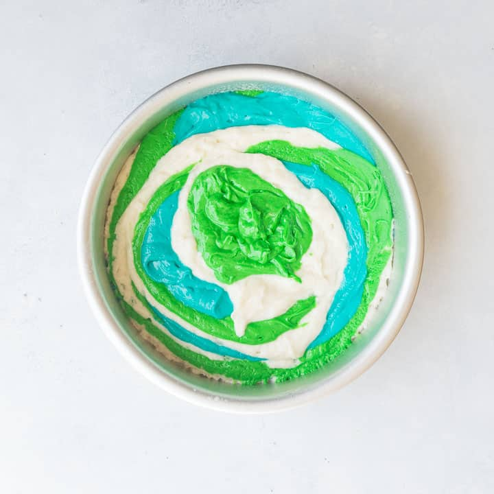 overhead image of the cake batter for the mermaid cake to illustrate how to layer the colored batter