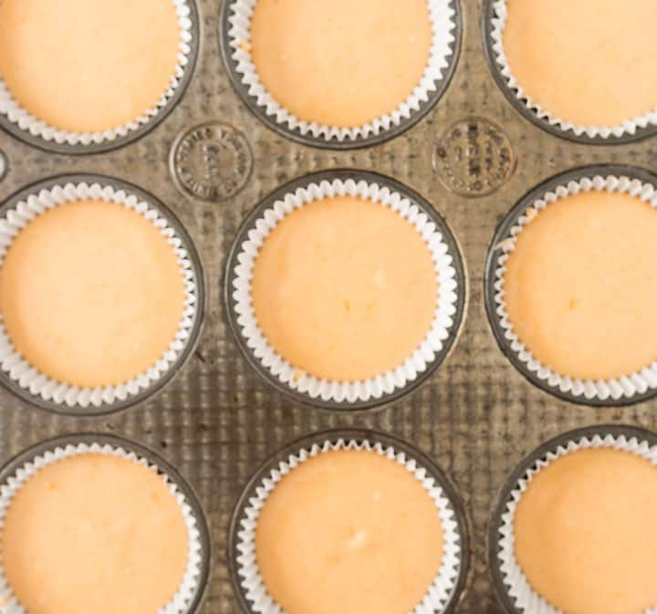 overhead photo of orange cupcakes before they're baked