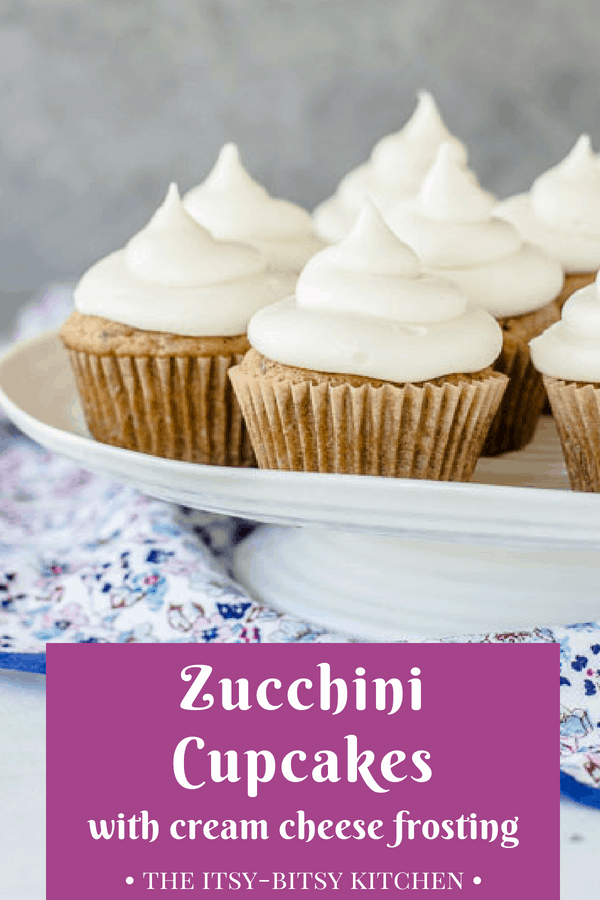 Zucchini cupcakes with cream cheese frosting are EASY to make and they're a delicious way to use up the zucchini you probably have growing in your garden. If you're looking for an easy summer dessert recipe then look no further! #zucchini #cupcakes #creamcheesefrosting
