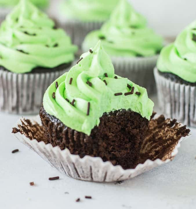 chocolate mint cupcake with a bite taken out of it
