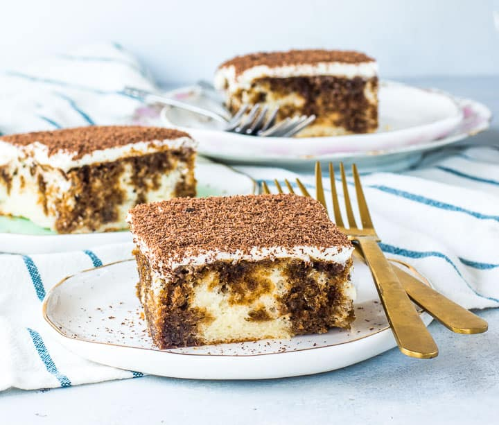 slice of easy tiramisu on a plate with more tiramisu in the background