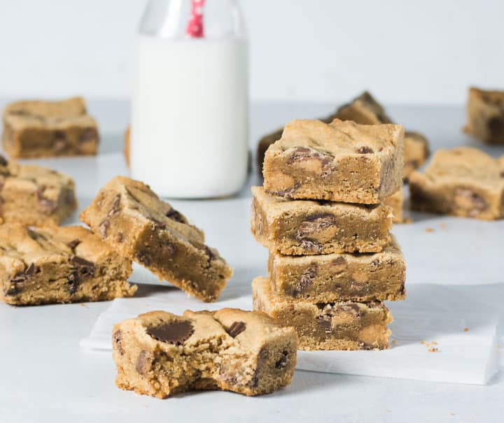 stack of peanut butter cookie bars with one bar in front of the stack