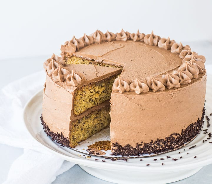 banana Nutella cake on a cake stand with two slices taken out