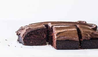 sliced chocolate dump cake with one piece missing