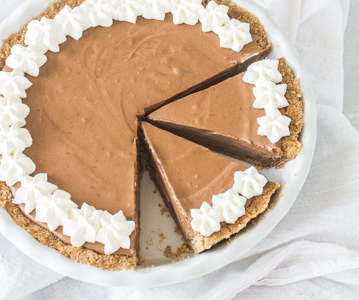 overhead photo of easy chocolate pie in a pie dish, sliced