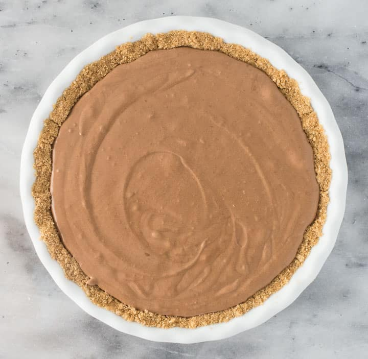 overhead photo of chocolate pie once the filling has been poured into the crust