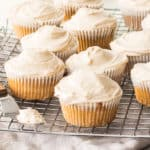 frosted maple cupcakes on a wire rack