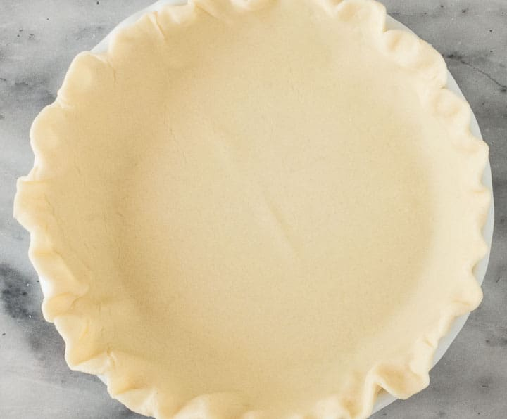 overhead photo of unbaked pie shell without pie filling