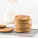 stack of speculoos cookies on a a wire rack and tied with a piece of red string