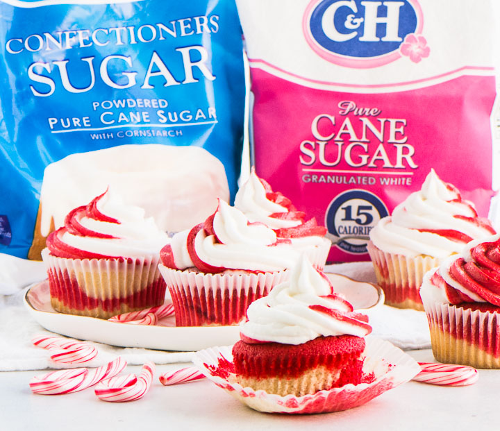 candy cane cupcakes with bags of C&H sugar in the background