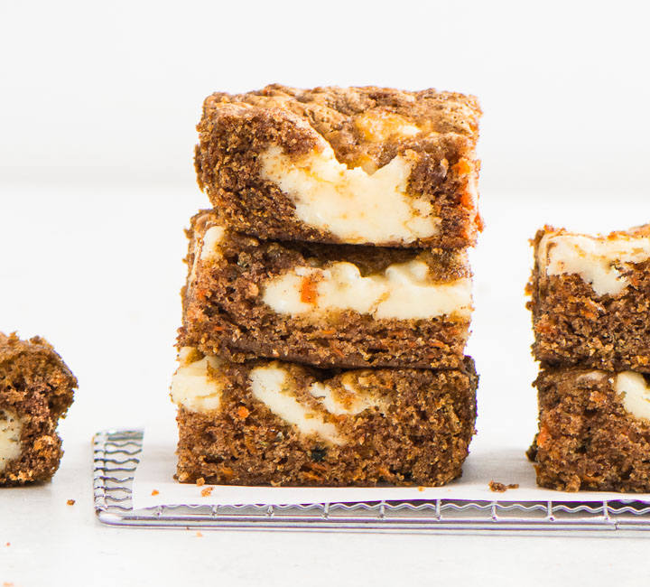 stack of carrot cake bars on a wire rack