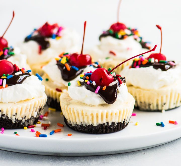 cupcakes on a large serving plate with sprinkles scattered around