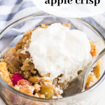 pinterest image with crisp in a bowl topped with whipped cream