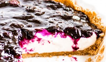 sliced blueberry cream pie in a pie dish