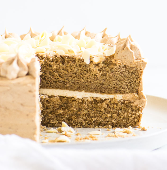 cappuccino cake on a cake stand, sliced to show the texture of the cake