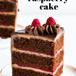 Pinterest image of sliced chocolate raspberry cake on a plate with text overlay