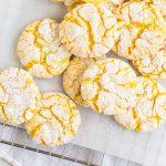 overhead photo of lemon crinkle cookies on a wire rack