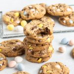 stack of cookies with Cadbury mini eggs and more cookies arranged around and behind them
